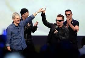 Apple's Tim Cook with the band U2