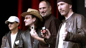 Beats executive Jimmy Iovine, Bono, Steven Jobs and The Edge at the launch of the iPod. Hmmm...