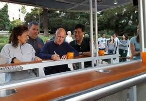 "Gov. Jerry Brown signs SB 350 at an informal ""brew bike"" in Sacramento. Photo courtesy of fox40.com"